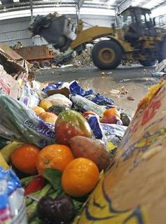 Expired fruits from a supermarket sit on the sorting floor at the Wilmington Organic Recycling Center in Wilmington, Delaware, January 8, 2010. REUTERS/Tim Shaffer