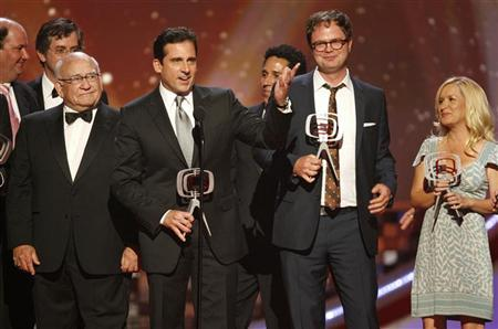 Presenter Ed Asner (L) looks on as the ensemble cast of the TV series ''The Office'' (2nd L-R) Steve Carrell, Oscar Nunez, Rainn Wilson and Angela Kinsey accept the Future Classic award at the taping of the 6th annual TV Land Awards in Santa Monica June 8, 2008. REUTERS/Fred Prouser