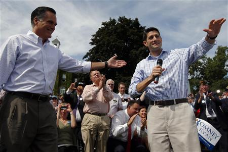 U.S. Republican presidential candidate and former Massachusetts Governor Mitt Romney (L) and vice-presidential candidate, U.S. Representative Paul Ryan (R-WI), hold a town hall meeting campaign stop in Manchester, New Hampshire August 20, 2012. REUTERS/Brian Snyder