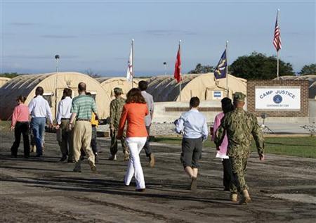 Members of the media pool move to the courtroom at the U.S. Navy base at Guantanamo Bay May 5, 2012. REUTERS/Walter Michot/Pool
