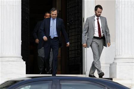 Greece's Prime Minister Antonis Samaras (C) leaves his office after a meeting with coalition party leaders in Athens August 1, 2012. REUTERS/Yorgos Karahalis