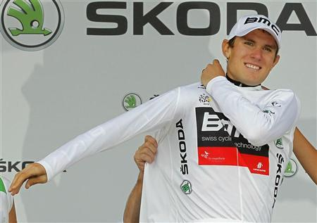BMC Racing Team rider Tejay Van Garderen of the U.S. and best young rider white jersey holder celebrates on the podium after the individual time trial of the 19th stage of the 99th Tour de France cycling race between Bonneval and Chartres, July 21, 2012. REUTERS/Stephane Mahe