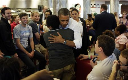 U.S. President Barack Obama receives a hug during a visit to Sloopy's diner at the Ohio State University in Columbus, Ohio August 21, 2012. REUTERS/Kevin Lamarque