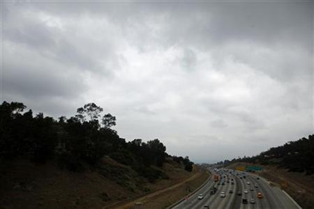 Traffic flows along a freeway in Los Angeles, California July 14, 2011. REUTERS/Eric Thayer