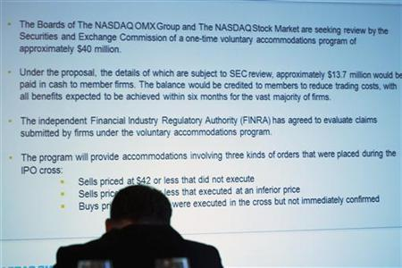 A screen shows a planned compensation scheme to cover issues with the IPO of Facebook during a speech by Nasdaq chief executive officer Robert Greifeld (not pictured) during the Sandler O'Neill + Partners, L.P. global exchange and brokerage conference in New York June 7, 2012. REUTERS/Lucas Jackson