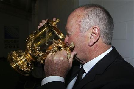 New Zealand All Blacks coach Graham Henry drinks from the Webb Ellis Cup as they celebrate after beating France in their final match to win the Rugby World Cup at Eden Park in Auckland October 23, 2011. REUTERS/David Rogers/Pool (