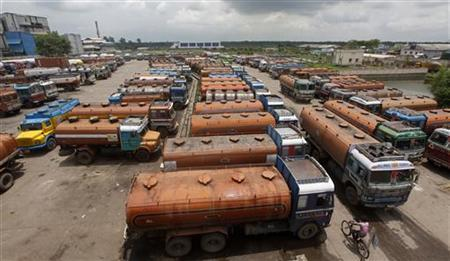 Parked diesel tankers are pictured on the outskirts of Kolkata August 14, 2012. REUTERS/Rupak De Chowdhuri