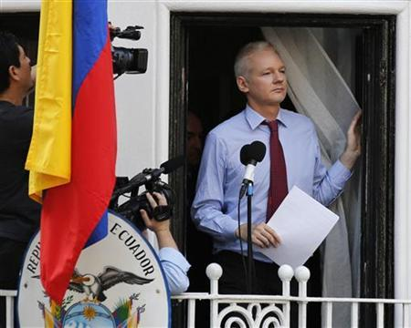 Wikileaks founder Julian Assange prepares to speak from the balcony of Ecuador's embassy, where he is taking refuge in London August 19, 2012. REUTERS/Chris Helgren