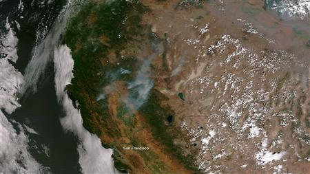 View from the Suomi NPP satellites shows smoke plumes from forest fires afflicting Northern California in this NOAA handout image dated August 20, 2012. REUTERS/NOAA/Handout