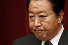 Japan's Prime Minister Yoshihiko Noda reacts during a news conference at his official residence in Tokyo August 10, 2012. REUTERS/Yuriko Nakao