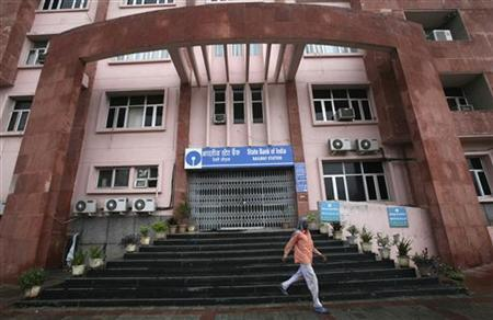 A man walks down the stairs of a bank during a two-day strike in Jammu August 22, 2012. REUTERS/Mukesh Gupta