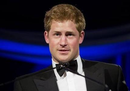Britain's Prince Harry speaks after receiving the Humanitarian Award from the Atlantic Council during their annual awards dinner in Washington May 7, 2012. REUTERS/Joshua Roberts/Files