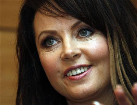 British soprano Sarah Brightman gestures during an interview with Reuters in Beijing August 9,2008. REUTERS/Eric Gaillard