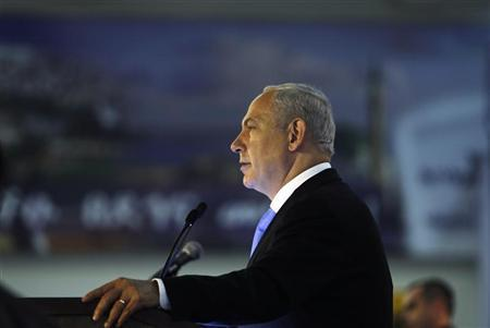 Israel's Prime Minister Benjamin Netanyahu speaks during a welcoming ceremony for Jewish immigrants from North America upon their arrival to Israel, at Ben Gurion International Airport near Tel Aviv August 14, 2012. REUTERS/Baz Ratner