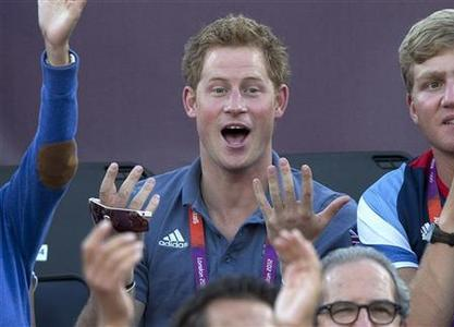 Britain's Prince Harry gestures as he watches the women's beach volleyball bronze medal match between Brazil and China at Horse Guards Parade during the London 2012 Olympic Games August 8, 2012. REUTERS/Neil Hall