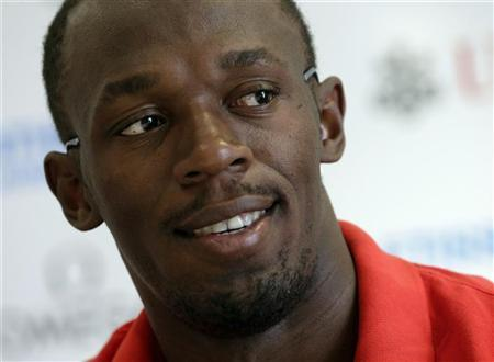 Jamaica's Usain Bolt smiles during a news conference ahead of the Athletissima Diamond League event in Lausanne, August 22, 2012. REUTERS/Denis Balibouse