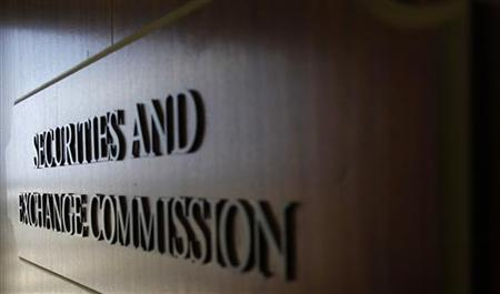 A sign for the Securities and Exchange Commission (SEC) is pictured in the foyer of the Fort Worth Regional Office in Fort Worth, Texas June 28, 2012. Picture taken June 28, 2012.REUTERS/Mike Stone
