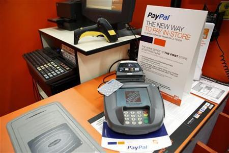A sign showing customers' ability to now pay with their PayPal account sits at a cashier station at a Home Depot store in Daly City, California, February 21, 2012. REUTERS/Beck Diefenbach