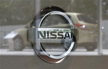 Nissan Motor Corp's logo is pictured as a Nissan vehicle is reflected on glass at the Nissan Gallery in Yokohama, south of Tokyo July 26, 2012. REUTERS/Yuriko Nakao