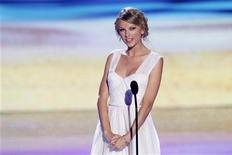 Singer Taylor Swift speaks on stage at the Teen Choice Awards at the Gibson amphitheater in Universal City, California July 22, 2012. REUTERS/Mario Anzuoni