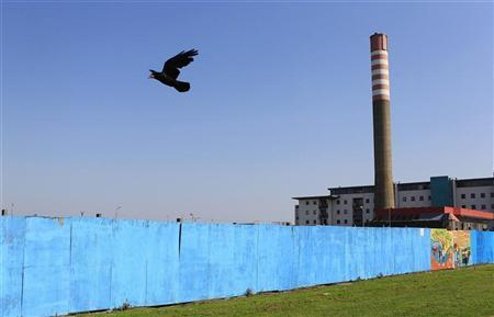 Blue hoarding hides an incomplete building project in North Dublin May 31, 2012. REUTERS/Cathal McNaughton