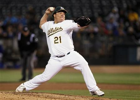 Oakland Athletics pitcher Bartolo Colon delivers a pitch during the sixth inning of their MLB baseball game against the Toronto Blue Jays in Oakland August 2, 2012. REUTERS/Beck Diefenbach