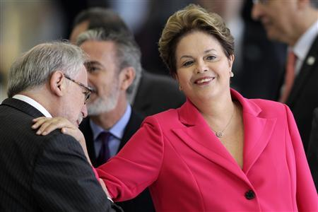 Brazil's President Dilma Rousseff (R) attends an arrival ceremony before a ceremony for signing acts between Brazil and Venezuela in the Planalto Palace July 31, 2012. REUTERS/Ueslei Marcelino/Files