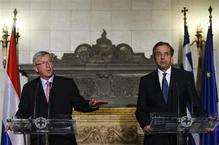 Luxembourg's Prime Minister and Eurogroup Chairman Jean-Claude Juncker (L) gestures next to Greece's Prime Minister Antonis Samaras during a news conference after their meeting in Athens August 22, 2012. REUTERS/John Kolesidis