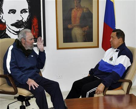 Former Cuban President Fidel Castro (L) visits Venezuela's President Hugo Chavez, who is recovering from surgery, in Havana March 2, 2012. REUTERS/Miraflores Palace/Handout