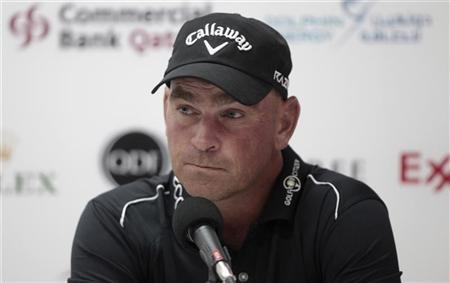 Thomas Bjorn of Denmark talks during a news conference at the Qatar Masters golf tournament in Doha February 1, 2012. REUTERS/Fadi Al-Assaad