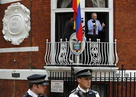 Wikileaks founder Julian Assange gestures as he speaks from the balcony of Ecuador's embassy, where he is taking refuge in London August 19, 2012. REUTERS/Chris Helgren