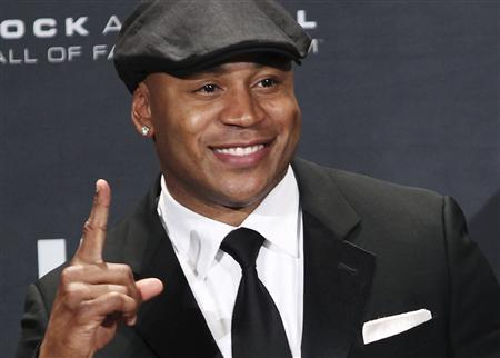 Rapper and television actor LL Cool J poses backstage after introducing the Beastie Boys at the Rock n' Roll Hall of Fame in Cleveland, Ohio in this April 14, 2012 file photo. LL Cool J fought a burglar in the kitchen of his Los Angeles house early on August 22, 2012 and held him there until officers arrived to take the man into custody, police said. REUTERS/Aaron Josefczyk/Files