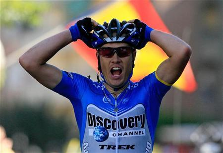 Discovery Channel's Tom Danielson celebrates as he cycles past the finish line of the 17th stage of the Tour of Spain cycling race between Adra and Granada September 13, 2006. REUTERS/Victor Fraile