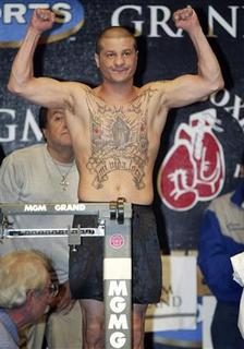 Featherweight boxer Johnny Tapia of Albuquerque, New Mexico, weighs in in Las Vegas in this November 1, 2002 file photo. Five-time World Boxing Champion Tapia died of heart disease exacerbated by prescription drugs, an autopsy report released on August 22, 2012 concluded. The 45-year-old boxer, who was found dead at his home in Albuquerque, New Mexico on May 27, died as a result of complications from hypertensive heart disease. Prescription drugs were a contributing factor, the autopsy report said. The cause of death was an accident. REUTERS/Steve Marcus/Files