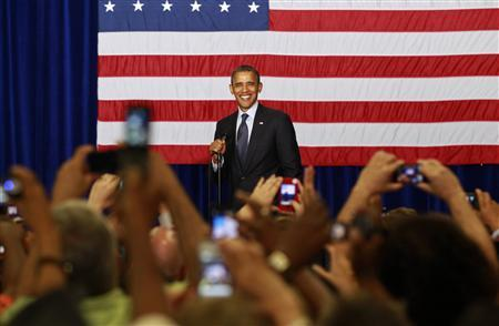 U.S. President Barack Obama smiles during a campaign event at Canyon Springs High School in Las Vegas, Nevada August 22, 2012. REUTERS/Kevin Lamarque