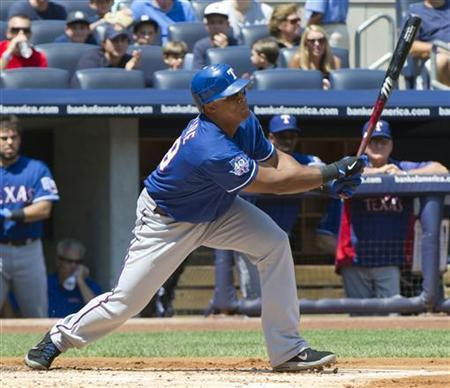 Texas Rangers batter Adrian Beltre hits a two-run single against the New York Yankees in the first inning of their MLB American League game at Yankee Stadium in New York, August 16, 2012. REUTERS/Ray Stubblebine