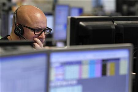 A trader monitors the screen on a trading floor in London January 22, 2010. REUTERS-Stefan Wermuth