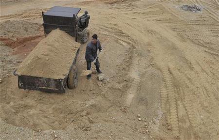 A labourer works at a site of a rare earth metals mine at Nancheng county, Jiangxi province March 14, 2012. REUTERS/Stringer