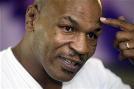 Former undisputed heavyweight boxing champion Mike Tyson points to his head during an interview at the MGM Grand Hotel and Casino in Las Vegas, Nevada March 23, 2012. REUTERS/Steve Marcus