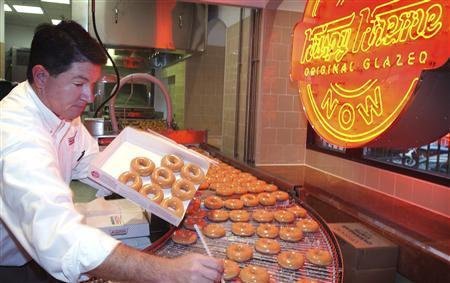Krispy Kreme doughnuts go into production at the opening of a store at Harrods in London, in this October 3, 2003 file photograph. REUTERS/David Bebber/Files