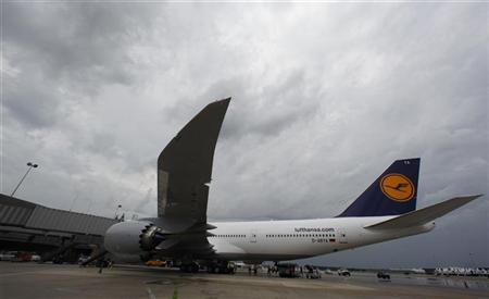 A Lufthansa Boeing 747-8 parks at the gate at Dulles International Airport outside Washington for the first time June 1, 2012. REUTERS/Larry Downing