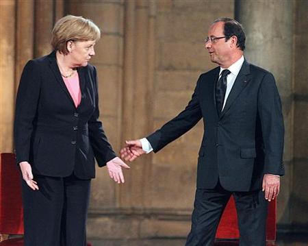 France's President Francois Hollande (R) and Germany's Chancellor Angela Merkel attend a ceremony in Reims Cathedral, July 8, 2012. REUTERS/Francois Nascimeni/Pool