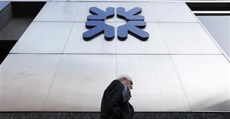 A pedestrian walks past an RBS branch in the City of London January 27, 2012. REUTERS/Suzanne Plunkett