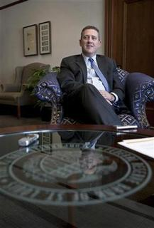 President and CEO of the Federal Reserve Bank of St. Louis James Bullard looks on during an interview at the Federal Reserve Bank of St. Louis June 8, 2011. REUTERS/Peter Newcomb