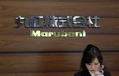 A receptionist works in front of the logo of Japanese trading house Marubeni Corp at the company's headquarters in Tokyo in this May 29, 2012 file photograph. REUTERS/Yuriko Nakao