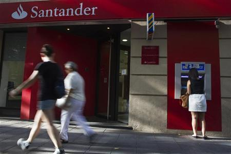 A woman uses an ATM machine at a Santander bank branch in Madrid July 26, 2012. REUTERS/Susana Vera