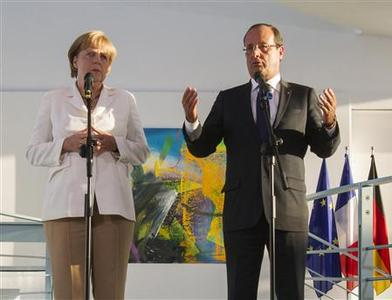 German Chancellor Angela Merkel (L) and France's President Francois Hollande address the media before talks at the Chancellery in Berlin, August 23, 2012. REUTERS/Thomas Peter