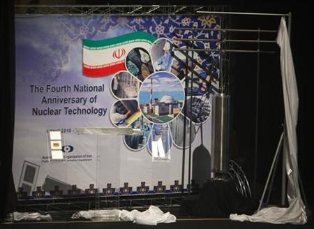 EDITORS' NOTE: Reuters and other foreign media are subject to Iranian restrictions on leaving the office to report, film or take pictures in Tehran. Objects representing nuclear fuel which will be used in Tehran's research reactor (L) and a sample of 3rd generation of centrifuges for uranium enrichment are unveiled during a ceremony to mark the Fourth National Anniversary of Nuclear Technology, in Tehran April 9, 2010. REUTERS/Morteza Nikoubazl