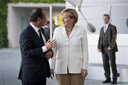 German Chancellor Angela Merkel (2nd L) talks with France's President Francois Hollande before a meeting at the Chancellery in Berlin, August 23, 2012. REUTERS/Jesco Denzel/BPA