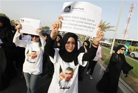 An anti-government protester holds a banner with a tweet by Bahrain human rights activists, Nabeel Rajab's as she participates in a march held to his home to support him, in Budaiya, west of Manama, May 31, 2012. REUTERS/Hamad I Mohammed